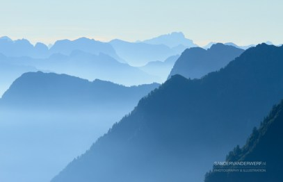 Layers of Ticino mountains during a blue dawn.