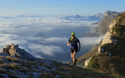 Athlete trailrunning in the mountains on a beautiful morning in the Vercors, France.