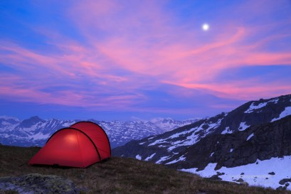 Tent at a mountain campsite in the Alps during an beautiful evening.