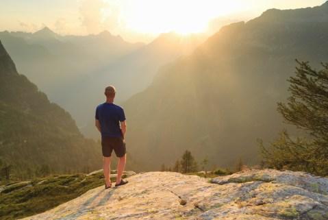 Hiker enjoying the summer view in Ticino, Switzerland.