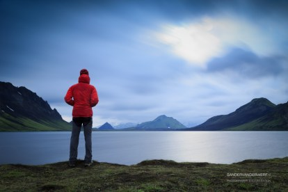 Hiker standing at lake Alftavatn.