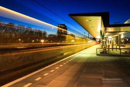 Train leaving a Dutch train station Europapark in the evening.