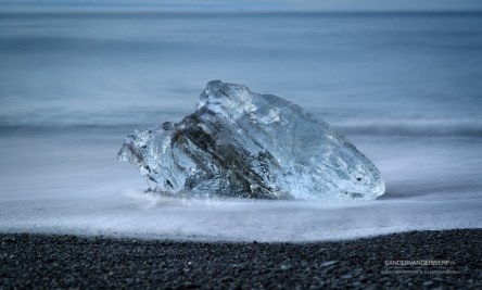 Ice and a wave on the beach near Jokulsarlon.