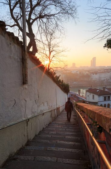 Walking down the stairs in Croix Rousse during sunrise.