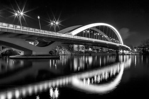 Illuminated bridge Raymond Barre over the Rhone river at night.