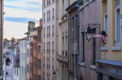 Trouble with a lantern in an old, colorful street in Croix Rousse.
