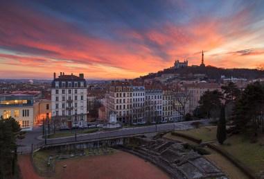 Colorful sunset at Amphitheatre des Troi Gaules and Basilica Notre-Dame de Fourviere.