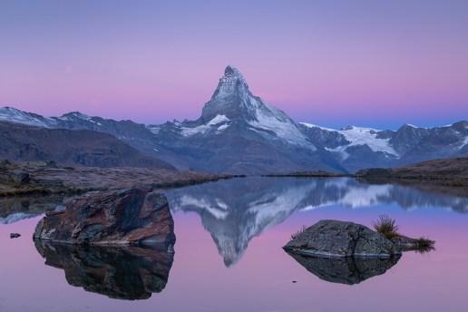 The famous Matterhorn reflected in the Stellisee during dawn. Zermatt, Switzerland.