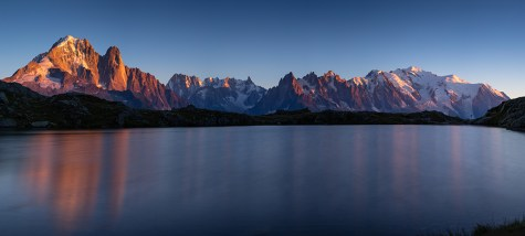 Panorama of the Alps near Chamonix, with Aiguille Verte, Auguille du Midi and Mont Blanc, during sunset at Lac des Cheserys.