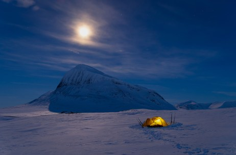 Tent in the snow covered mountains of Sarek National Park. Lapland, Sweden.