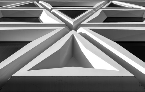 Triangles and abstract shapes in a modern facade.