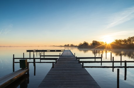 Tranquil sunrise at a jetty at the Leekstermeer, Holland.