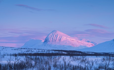 The mountain Nijak in National Park Sarek in the last sunlight of a winters day.