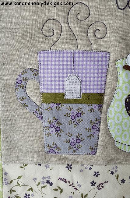 Sandra Healy Designs 'Warm Wishes' pillow pattern, mug detail