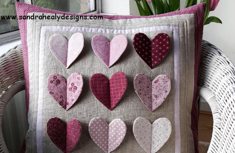 Sandra Healy Designs fluttering hearts pillow