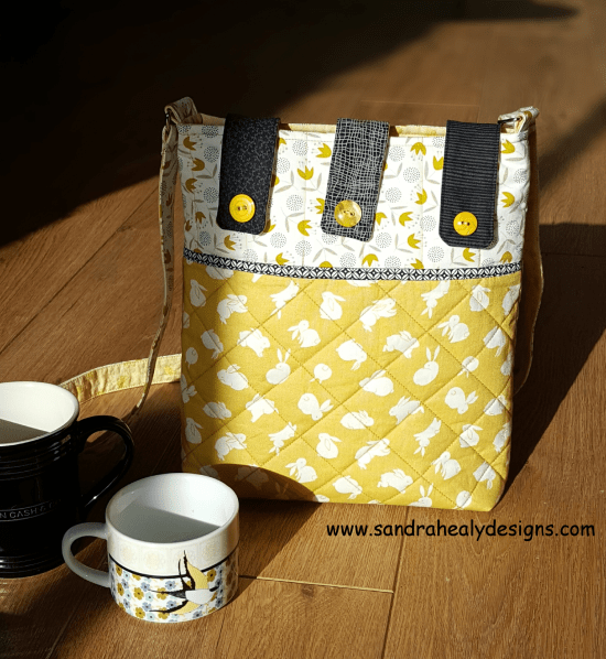 Sandra Healy Designs Button Tab Messenger Bag in yellow