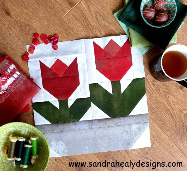 Sandra Healy Designs red tulip quilt block