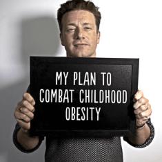 Jamie Oliver holding sign against childhood obesity
