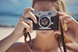 Woman holds a photo camera