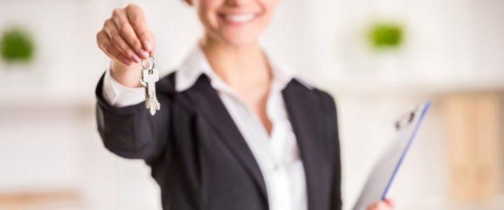 Property manager holding a key and clipboard