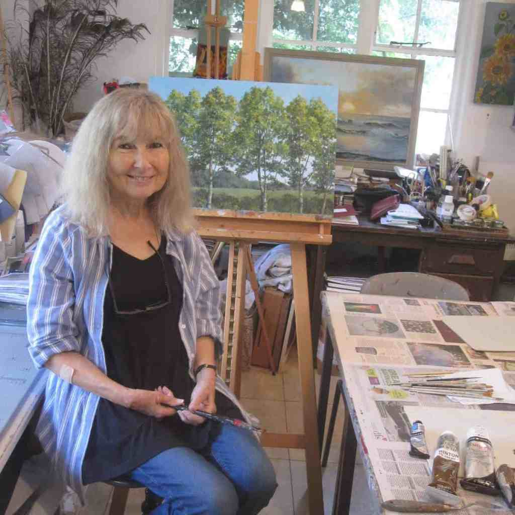 Photo of artist and author, Alexandra Kendall (Sandy) in her studio
