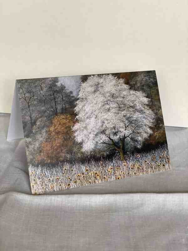 Photo of 'Sunflowers in frost' greetings card open on surface