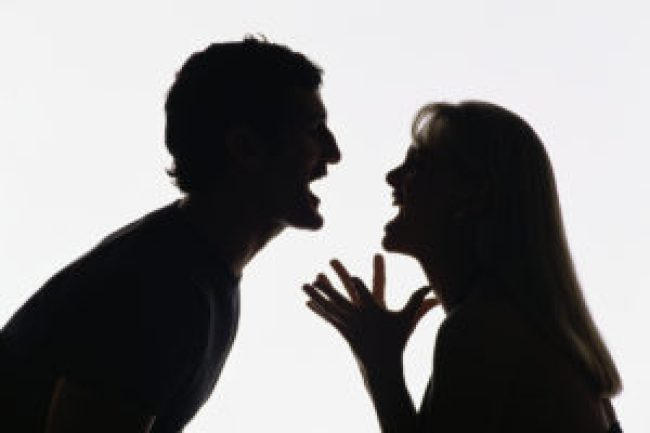 The Adobe Image Library ©1998 Adobe Systems Incorporated Silhouette of man and woman fighting