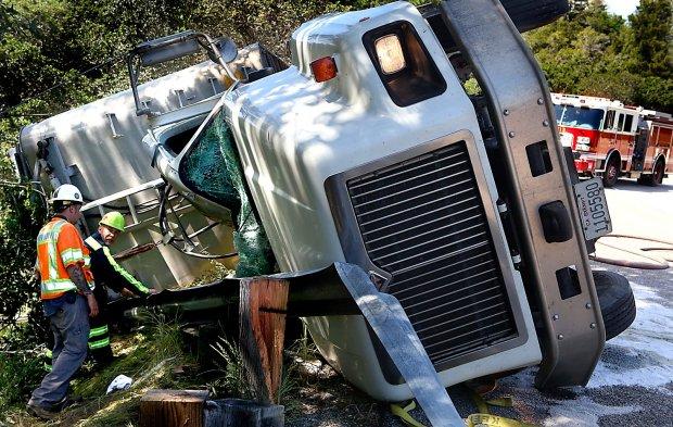 Traffic delay   Big rig driver injured by rollover near