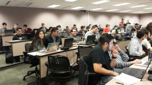 A packed room of students prepare for the start of a one unit course on quality software engineering. The course spanned two full Saturdays and was taught by Erik Eldridge, an engineer at Twitter. Contributed.