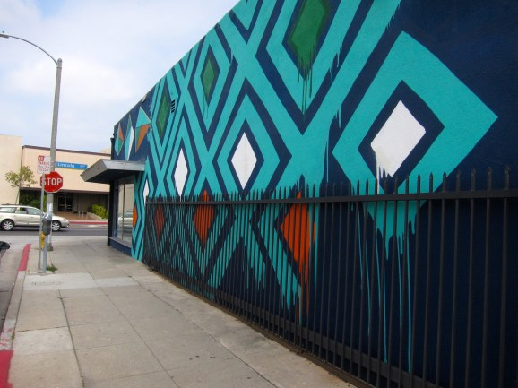 This mural on the side wall of the Printing Palace on Lincoln Boulevard has generated attention, according to the store manager, but not done much to improve business.