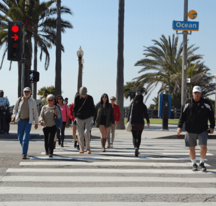 People crossing Ocean Avenue into Downtown Santa Monica from Palisades Park. Photo via the Pedestrian Action Plan.