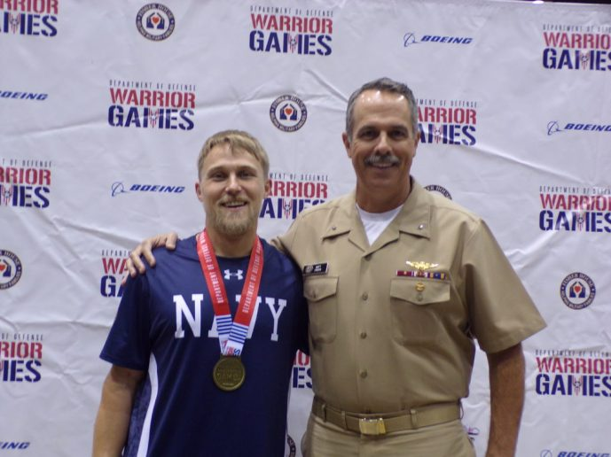 O'Keefe (right) with Petty Officer 2nd Class Joe Engfer, who won the gold medal for the air rifle competition.