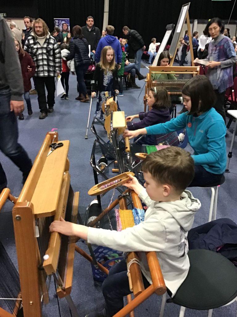 3 kids weaving