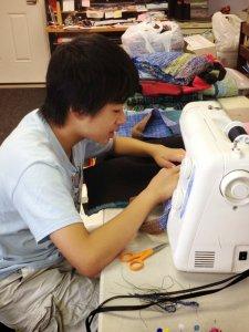 Arthur sewing