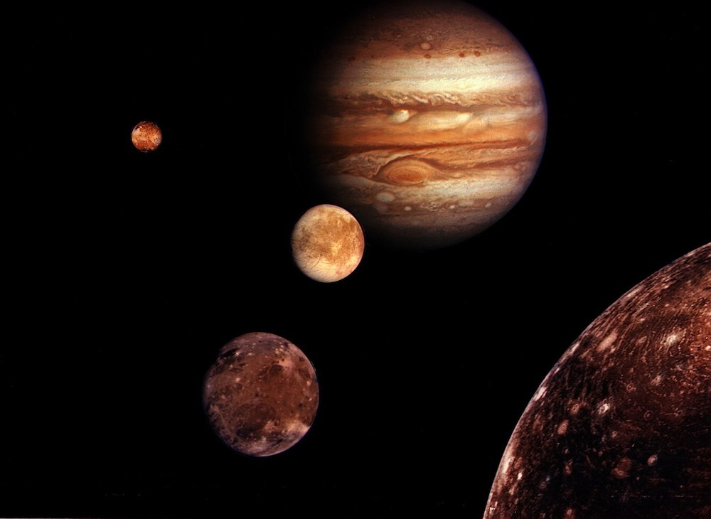 anthropology extraterrestrial life - This montage of photos captured by NASA probe Voyager 1 shows Europa (third from the left), a moon of Jupiter (center right) that holds an ocean under its icy surface.