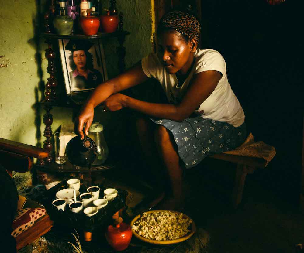 coffee rituals - A woman in Ethiopia prepares a buna (coffee) ceremony at home.