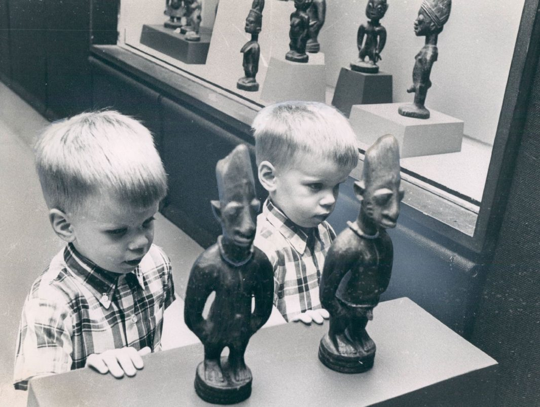 do twins share soul - The author and his twin pose with ère ìbejì on display at a 1967 Field Museum exhibition.