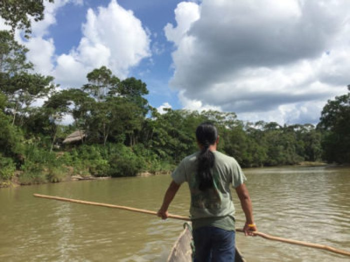 Eduardo Kohn Sarayaku - A river guide steers a canoe along the hourslong journey to the Sarayaku territory in Ecuador.