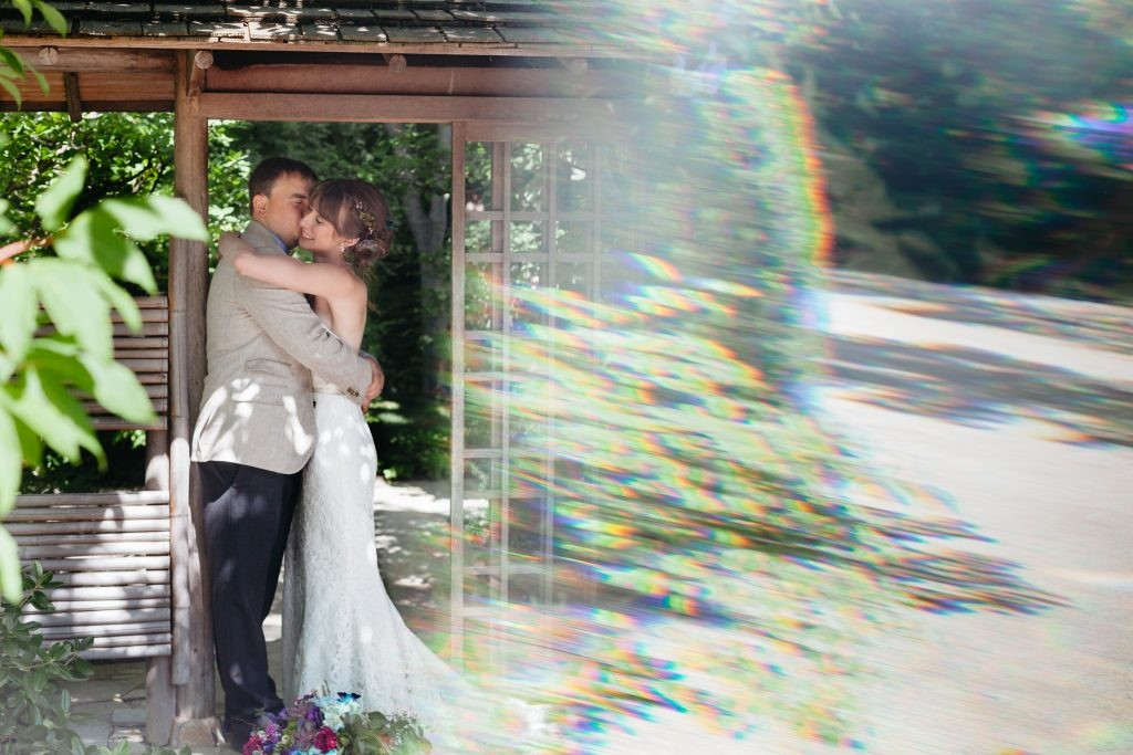 Artsy Bride and Groom on their summer wedding day at Anderson Japanese Gardens in Rockford, Illinois. Sara Johnson Photography