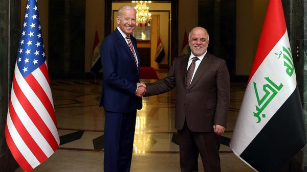"""A handout picture released by the Iraqi Prime Minister Haider al-Abadi's office on April 28, 2016 shows him (R) shaking hands with US Vice President Joe Biden following a meeting in Baghdad. Biden arrived in Baghdad for an unannounced visit to Iraq, whose leadership is bogged down in a protracted political crisis even as its forces battle jihadists. """"The vice president has arrived in Iraq for meetings with (the) Iraqi leadership focused on encouraging Iraqi national unity and continued momentum in the fight against ISIL,"""" a statement from Biden's office said, using an acronym for the Islamic State jihadist group. / AFP PHOTO / IRAQI PRIME MINISTER'S OFFICE / Handout / === RESTRICTED TO EDITORIAL USE - MANDATORY CREDIT """"AFP PHOTO / HO / IRAQI PRIME MINISTER'S OFFICE """" - NO MARKETING NO ADVERTISING CAMPAIGNS - DISTRIBUTED AS A SERVICE TO CLIENTS ==="""