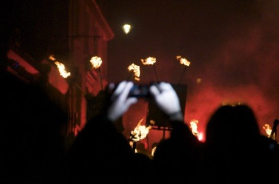 Hands taking a photo, Lewes Bonfire parade, Sussex