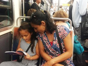 Sarah Badat Richardson homeschooling daughter in Subway Paris