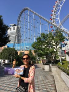 Sarah Badat Richardson in front of Thunder Dolphin roller coaster