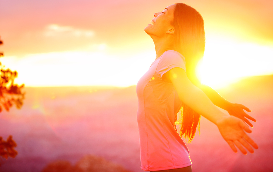 Free happy woman enjoying nature sunset. Freedom, happiness and enjoyment concept of beautiful multi