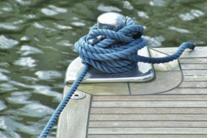 Rope tied to dock. This represents the message of the angel number 22 to free yourself from what is holding you back.