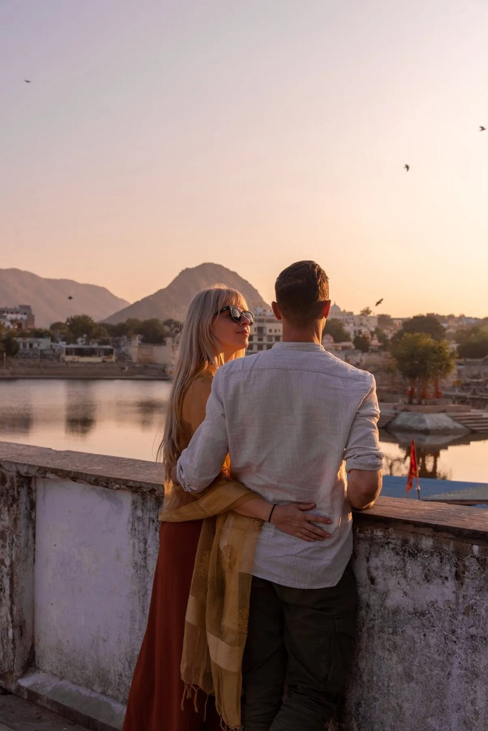 Couple admiring sunset in Pushkar