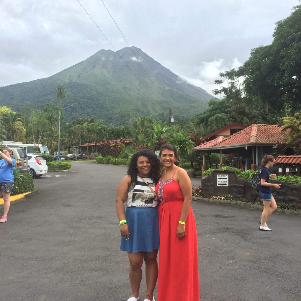 two girls standing in front of Arenal Volcano, Costa Rica