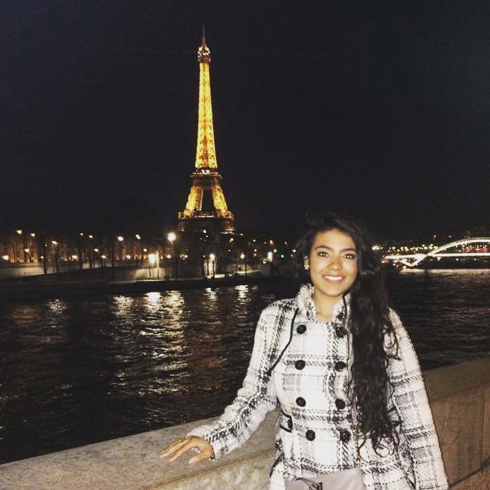 2 Days in Paris: girl in plaid coat in front of Eiffel Tower