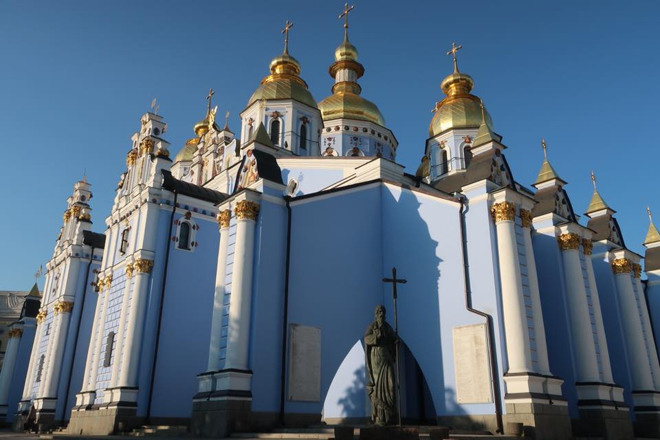 light blue orthodox church with gold domes