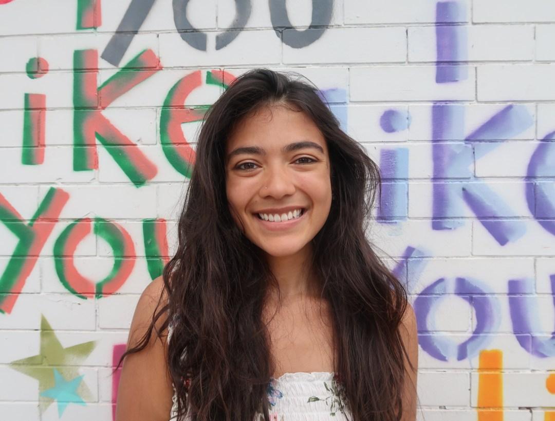 girl in front of mural